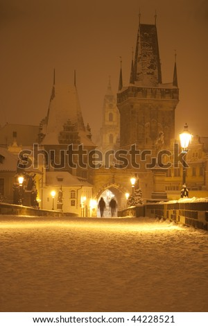 People on the Charles bridge in the night - stock photo