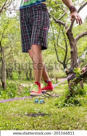 People on the nature walk in the sling and rest - Slack line - stock photo
