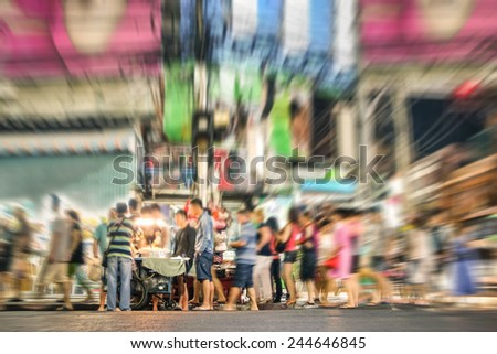 People on the road in Pattaya nightlife - International tourists and thai asian locals on walking street at night hours in thailand urban area - Image edited with radial zoom defocusing - stock photo