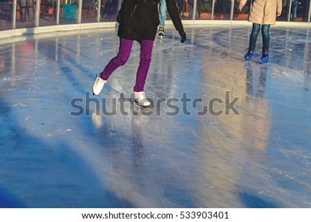 People on the street rink at the fair
