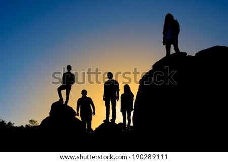 People on top of rocky mountains - stock photo