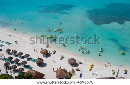 People on vacation on the beach at a resort hotel in cancun mexico - stock photo