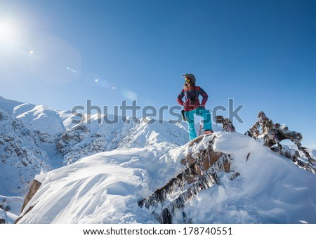 People on winter vacation, skiing and snowboarding, a lot of joy - stock photo