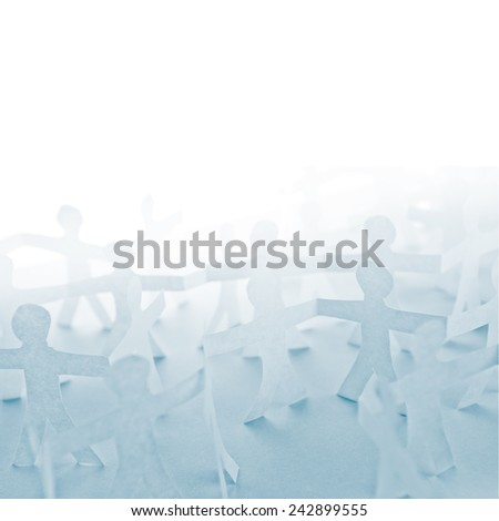 People Paper Cut Chain as Crowd or Teamwork Abstract Concept with White Copy Space - stock photo