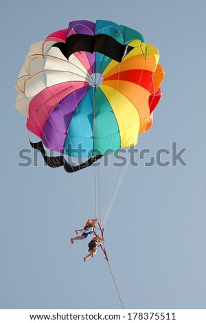 People parasailing - stock photo