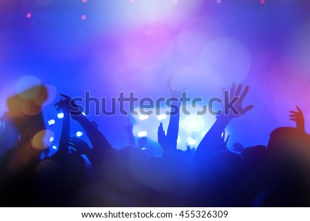People partying at a concert and enjoying live music