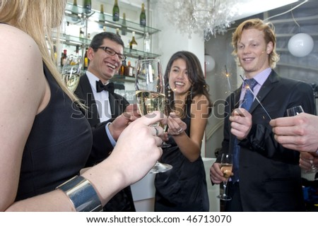 People partying on new years eve, or any other festive celebration - stock photo