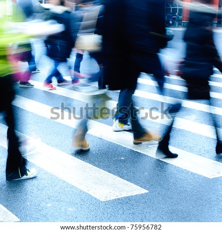 people person on zebra crossing street blur motion - stock photo