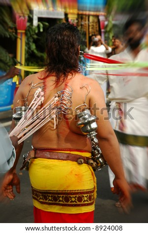 People piercing on body during a traditional Indian religious festival. - stock photo