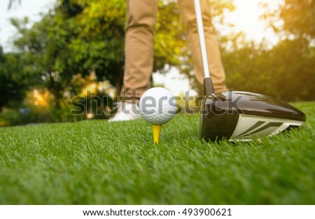 People player golf swing shot on grass in the summer day