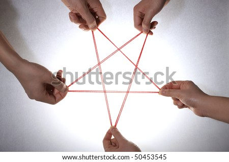 People playing cats cradle game - stock photo