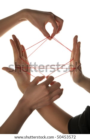 People playing cats cradle game,close-up - stock photo