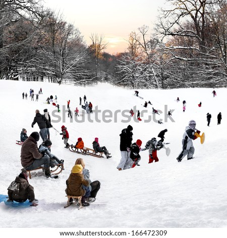 People playing in the winter park. Winter landscape.