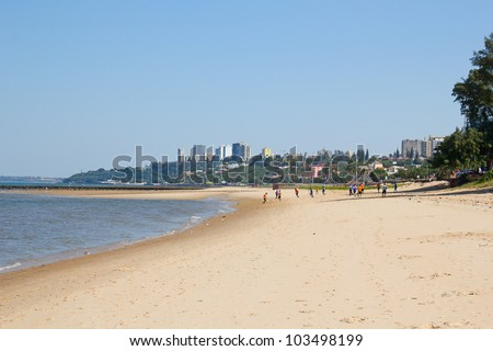 People playing soccer on the beach in Maputo, Mozambique - stock photo