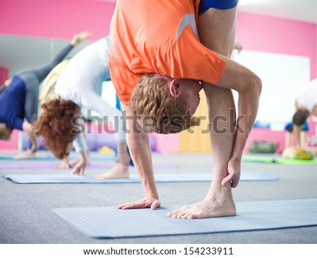 people practicing yoga at health club - stock photo