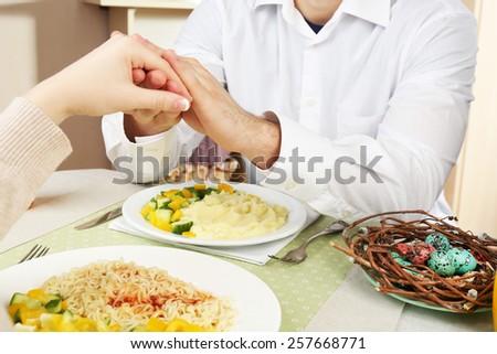 People praying before eating - stock photo