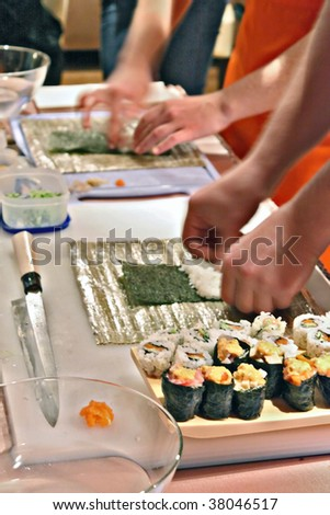 people  preparing sushi in the  kitchen - stock photo
