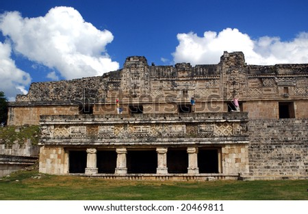 people prey on the stage of maya ruins, Uxmal, Mexico