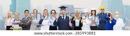 people, profession, education and success concept - happy bachelor with diploma over different workers over city background - stock photo