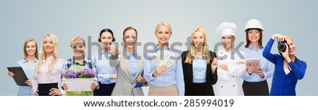 people, profession, employment, compensation and finances concept - happy businesswoman holding dollar money with group of professional workers over blue background - stock photo