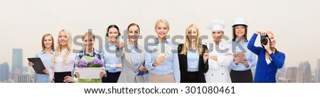 people, profession, employment, compensation and finances concept - happy businesswoman holding dollar money with group of professional workers over city background - stock photo