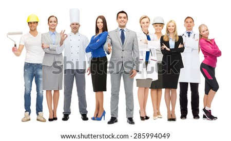 people, profession, qualification, employment and success concept - happy businessman over group of professional workers showing thumbs up