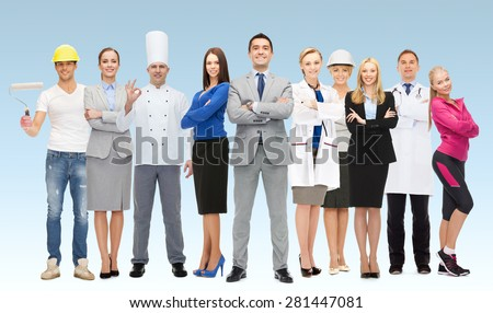 people, profession, qualification, employment and success concept - happy businessman with group of professional workers over blue background - stock photo