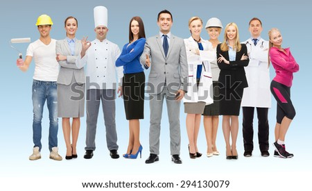 people, profession, qualification, employment and success concept - happy businessman with group of professional workers showing thumbs up over blue background - stock photo