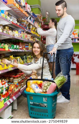 People purchasing a food for week at supermarket  - stock photo
