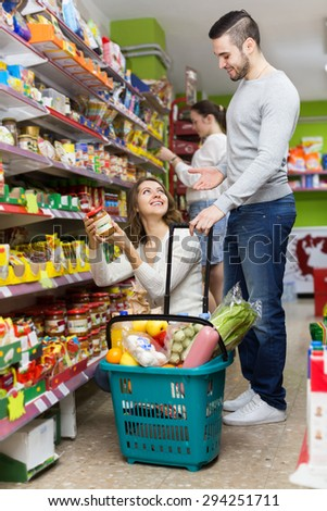People purchasing a food for week at the supermarket  - stock photo