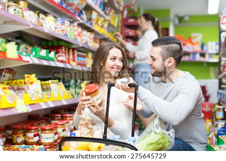 People purchasing a food for week in supermarket  - stock photo