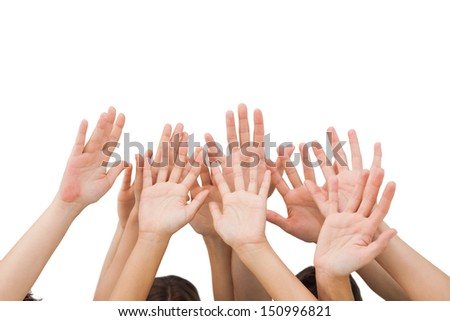 People raising hands in the air on white background