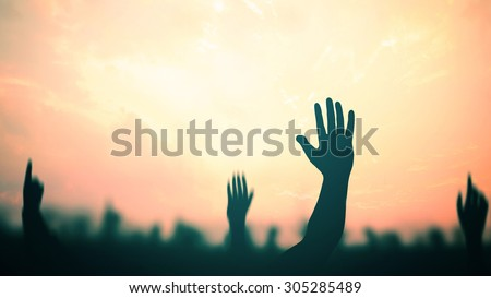 People raising hands on blur light night sky background. Human Right Day Worship Praise Christian Religion Adore Cross Good Friday Death Disciples Presidents Resurrection Help Labor Labour God concept - stock photo