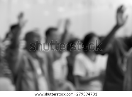 People raising hands to worship with singing choir for religion background - stock photo