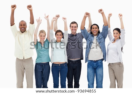 People raising their arms against white background - stock photo