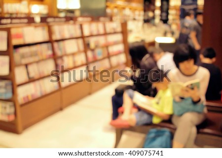 People reading in bookstore de focused abstract background