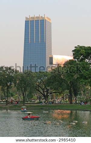 People relax on a boat in a city park - stock photo