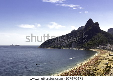 People relaxing during carnival on Ipanema Beach - stock photo
