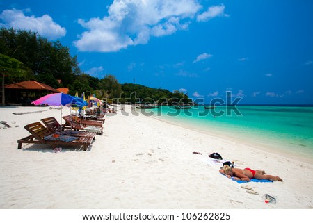 People Relaxing On A Bundhaya Beach Koh Lipe Thailand