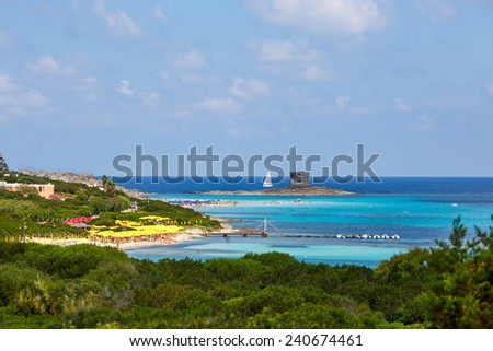 People relaxing on the La Pelosa beach located in the north of Sardinia island - stock photo