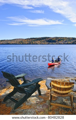 People returning from canoe trip on Lake of Two Rivers, Ontario, Canada - stock photo