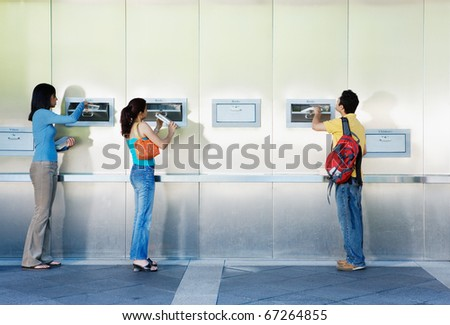 People returning library books - stock photo