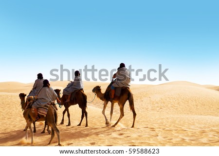 People ridding by camel