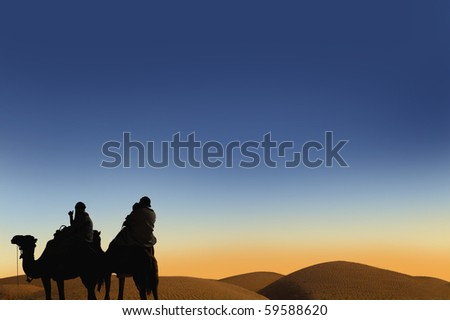 People ridding by camel on the sunset