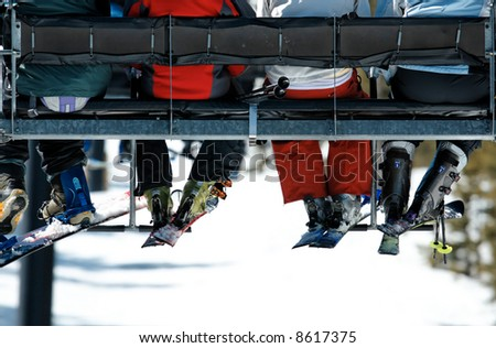 People riding on ski lift. Rear View. No Faces. Copy space. - stock photo
