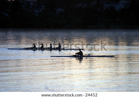 "people rowing on ""green lake"" at sunrise in ""seattle washington"""