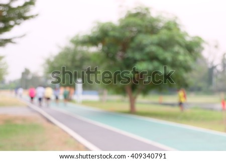 People run on street in Park ,blurred background