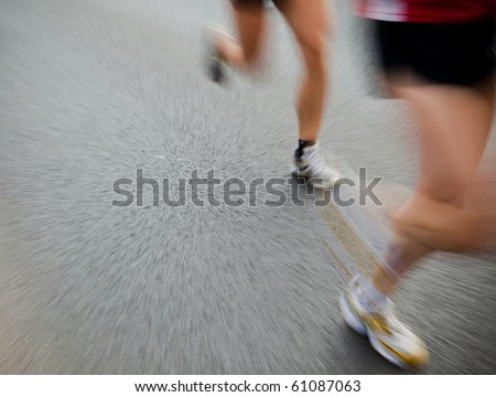People running in city marathon - stock photo