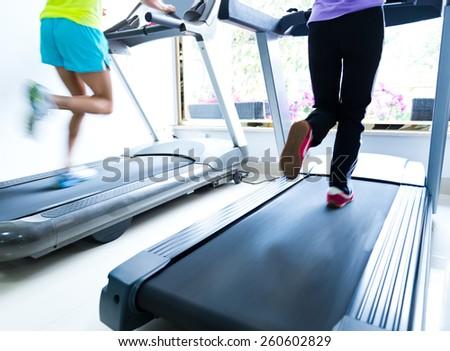 People running on a treadmill - stock photo