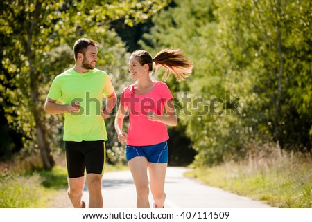 People running together and talking in summer sunny nature - stock photo